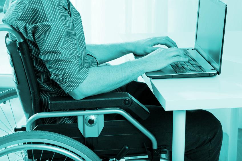 Fotoband, man in rolstoel aan het werk